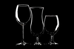 Glasses for wine, beer and cocktail on black background Royalty Free Stock Image