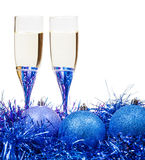 Glasses of wine at blue and violet Xmas baubles Royalty Free Stock Photos