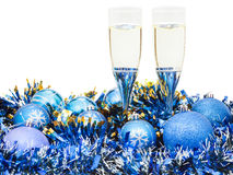 Glasses of wine and blue Xmas balls and tinsel Stock Images