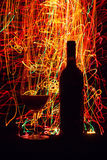 Glasses and wine bottle on black background Stock Image
