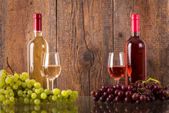 Glasses of wine with bottles and grapes stock images