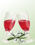 Glasses of wine and a bouquet of snowdrops. Stock Photo