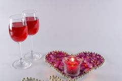 Glasses of wine and candles. On a white background are glasses of wine and candles Stock Photo