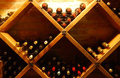 Glasses in a wine-cellar. Old bottles in a wine-cellar Stock Photos