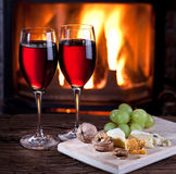 Glasses of wine, cheese and nuts. Royalty Free Stock Images