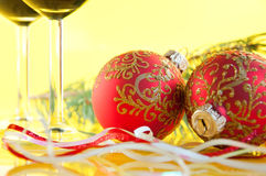 glasses of wine and Christmas balls Royalty Free Stock Photos