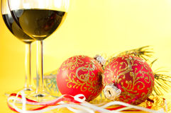 Glasses of wine and Christmas balls Royalty Free Stock Photo