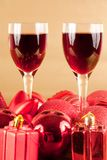 Glasses of wine with Christmas decoration. Two glasses of wine with Christmas decorations Stock Photo