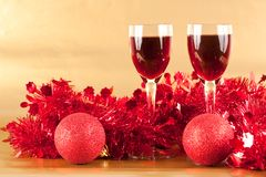 Glasses of wine with Christmas decoration. Two glasses of wine with Christmas decorations Royalty Free Stock Photography