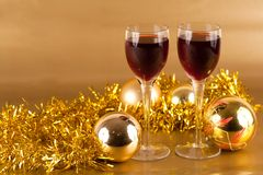 Glasses of wine with Christmas decorations. Two glasses of wine with Christmas decorations Stock Images
