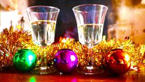 Glasses of wine and Christmas decorations on the background of a fireplace. Glasses of wine and Christmas decorations on the background of a burning fireplace stock video