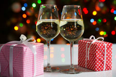 Glasses of wine and christmas gifts Stock Photography