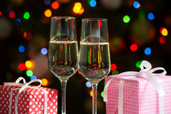 Glasses of wine and christmas gifts Stock Photo