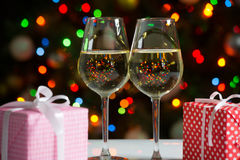 Glasses of wine and christmas gifts Royalty Free Stock Images