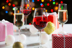 Glasses of wine and christmas gifts Royalty Free Stock Photo