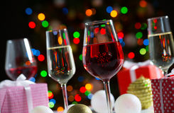Glasses of wine and christmas gifts Royalty Free Stock Image