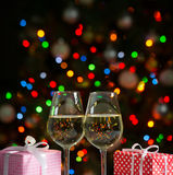 Glasses of wine and christmas gifts Stock Image