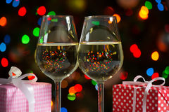 Glasses of wine and christmas gifts Stock Images