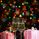 Glasses of wine and christmas gifts Stock Photos