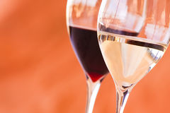 Glasses of wine. Close up of two glasses of red and white wine Royalty Free Stock Photo