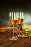 Glasses of Wine, Cured Meat and Olives on Table stock photos