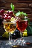 Glasses of wine on dark wooden background, vertical Stock Image