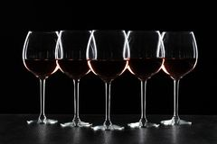Glasses of wine in darkness royalty free stock photos