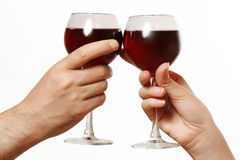 Glasses of wine in a female and a male hand Royalty Free Stock Photography