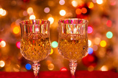 Glasses with wine. Glasses of wine with festive light effects background Royalty Free Stock Photo