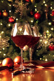 Glasses of wine in front of Christmas tree Royalty Free Stock Photography
