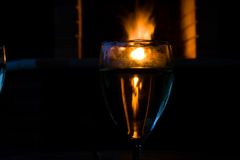 Glasses of wine in front of a fireplace Royalty Free Stock Images