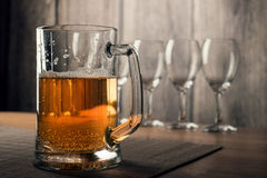 Glasses of wine and a mug of beer Royalty Free Stock Images