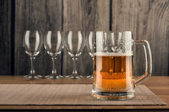 Glasses of wine and a mug of beer Stock Images