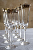 Glasses of wine glasses. Illuminated champagne glasses standing on stole.novy year corporate Christmas holiday party Royalty Free Stock Photo
