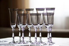 Glasses of wine glasses. Illuminated champagne glasses standing on stole.novy year corporate Christmas holiday party Royalty Free Stock Image