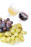 Glasses of wine with grapes Royalty Free Stock Photos