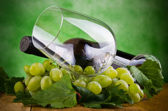 Glasses of wine and grapes Stock Photos