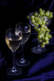 Glasses of wine and grapes on a dark background Stock Photo