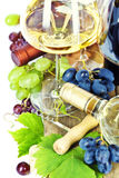 Glasses of  wine and grapes over white Stock Images