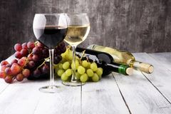 Glasses of wine and grapes on wooden background. red and white w. Ine concept royalty free stock images