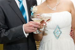 Glasses of wine in the hands of the bride and groom Stock Image