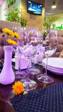 Glasses of wine on laid table Stock Images