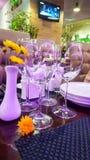 Glasses of wine on laid table. Interior. Glasses of wine on laid table stock images