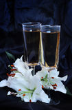 Glasses with wine and lily flowe Stock Image