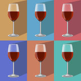Glasses of wine on metal stand.  Stock Images