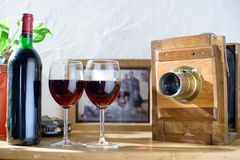 Glasses of wine with an old camera Royalty Free Stock Images