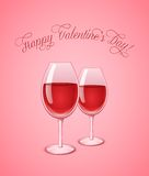 Glasses of wine on pink background Stock Images
