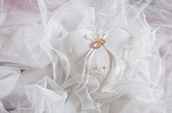 Rings on a pillow. Wedding rings lie on a bed Royalty Free Stock Image