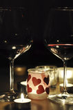 2 glasses of wine by romantic candle light Royalty Free Stock Image