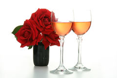 Glasses of wine and rose Stock Photography